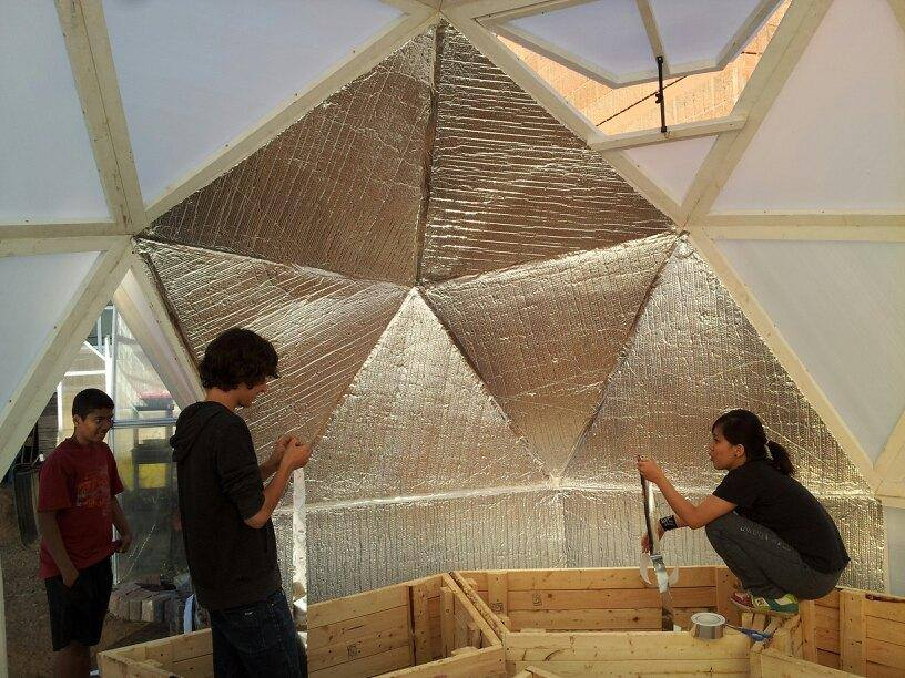 Inside the dome greenhouse structure students learn to grow food