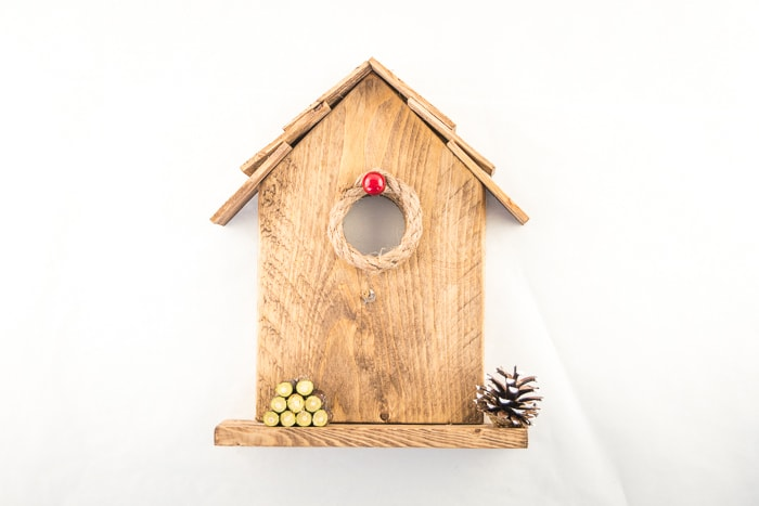 Cute rustic birdhouse ornament ready to brighten up your mantle or table display.