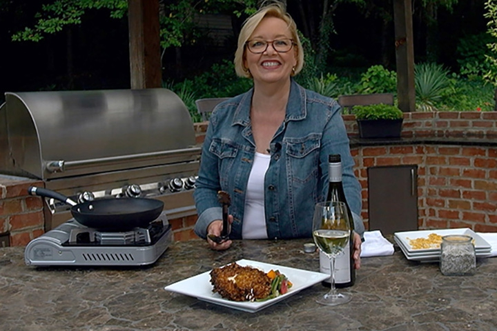 grilling chicken outdoors on a patio