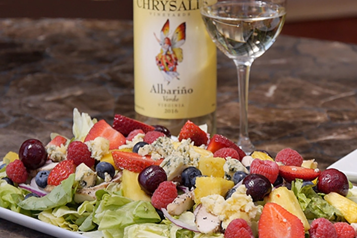 fruit salad with glass of wine