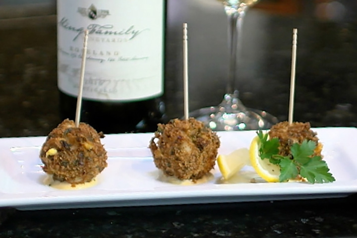 crab cakes on a plate with wine