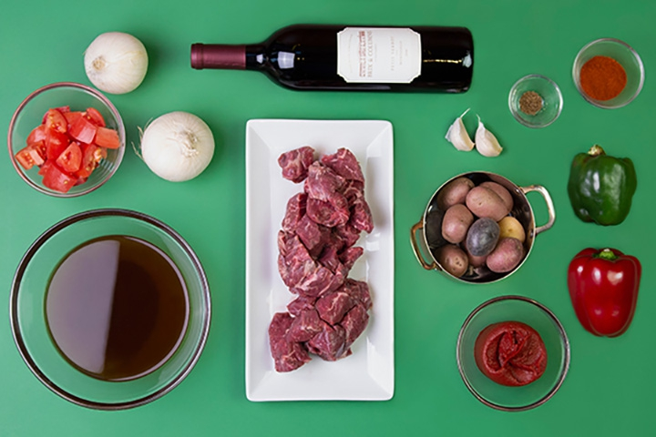 cooking ingredients. Steak, onions, wine, spices