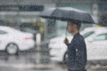 man with umbrella on rainy day