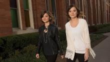 two women walking infront of church