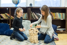 kids building tower on floor