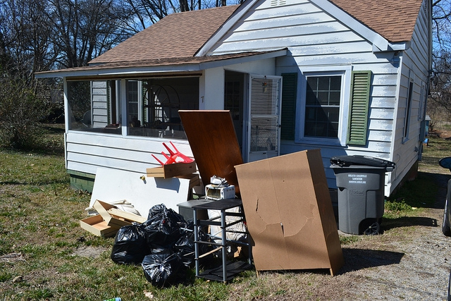 A home with the occupant's belongings in the front yard.