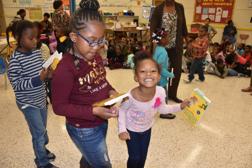Students at Richmond's Woodville ES received a book to take home Weds.