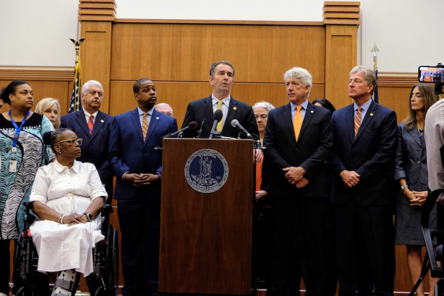 Gov. Northam at a press conference on Tuesday, flanked by Lt. Gov. Justin Fairfax (left) and Attorney General Mark Herring (right).
