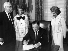 Virginia governor Mills Godwin signs a bill to create Virginia Commonwealth University during his first term in 1968.