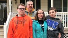Alex Campbell (far left) is pictured outside his Powhatan County home with father Sean, mother Kelly and brother Jack.