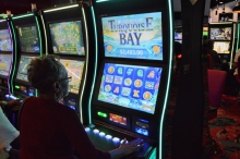 """A customer plays a """"historical horse racing"""" machine at Colonial Downs on Tuesday."""