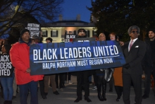 Around two dozen black politicians and activists gathered in front of the Executive Mansion on Wednesday night to urge Governor Ralph Northam to resign.