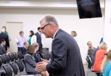 Sec. of Finance Aubrey Layne speaks to a colleague at a House Appropriations meeting on Monday.