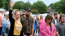 People gather at a vigil for victims of a mass shooting at a municipal building in Virginia Beach, Va.
