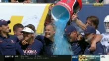 ESPN broadcast footage of Coach Lars Tiffany getting doused.