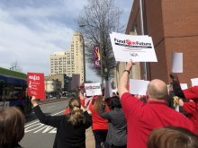 Educators rally for funding outside the VEA Conference in Richmond.