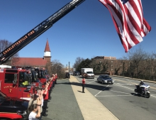 Two dozen firefighters stood as the convoy passed the Charlottesville firehouse.