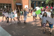 Students across the globe staged strikes in the name of the climate Friday [05/24]. One such strike, which took place in Charlottesville, was organized by a pair of fifth graders