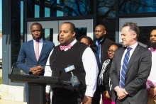 Richmond Education Association President Ramon Moore, center, says his members support Mayor Levar Stoney's proposed 2020 budget.