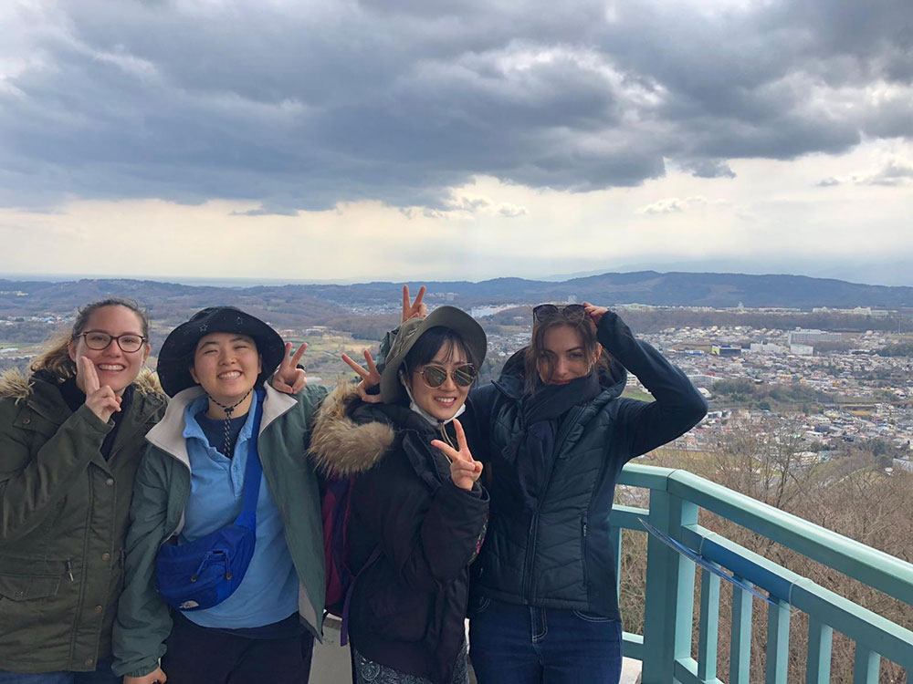 Anna, Lya, Meg, and Kyejin went hiking