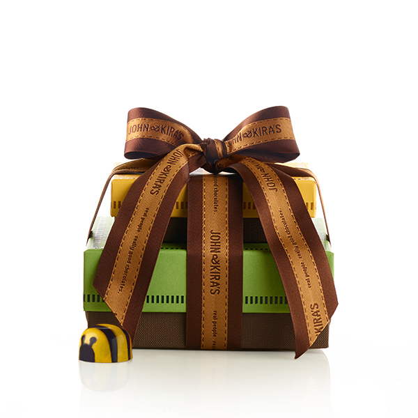 Artisan Tower, a six piece yellow box of Bees atop a square green boutique box of Ladybugs