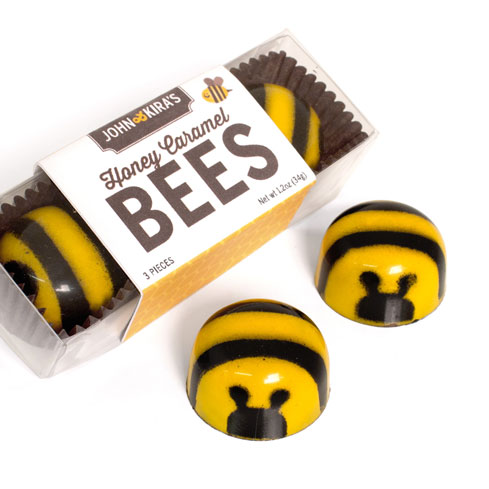 Three Caramel Chocolate Bees in a clear plastic box