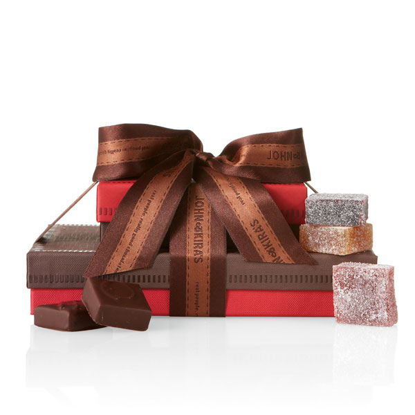 An assortment of two boutique boxes tied with a festive bow