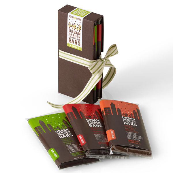 Mint, Orange Rosemary, and Chili Bars in a brown box set tied with ribbon