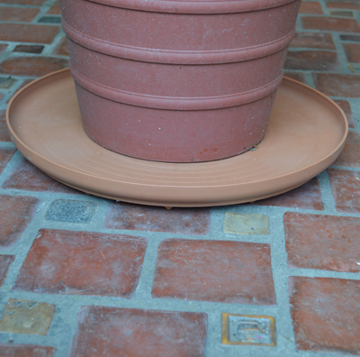 "12"" Terracotta Colored Plant Turner"