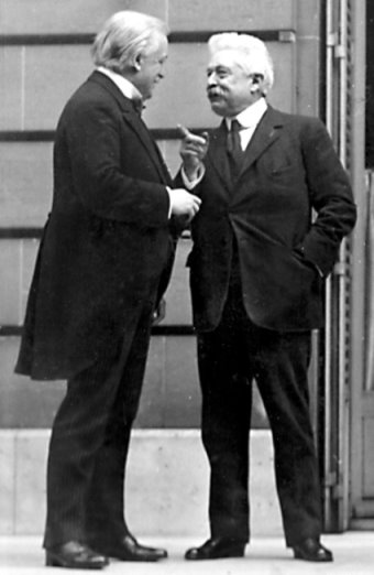 An old photograph of two men talking