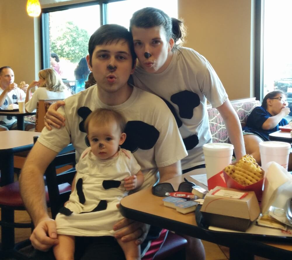 Brian, Melissa, and Lydia dressed up as cows at Chik-Fil-A