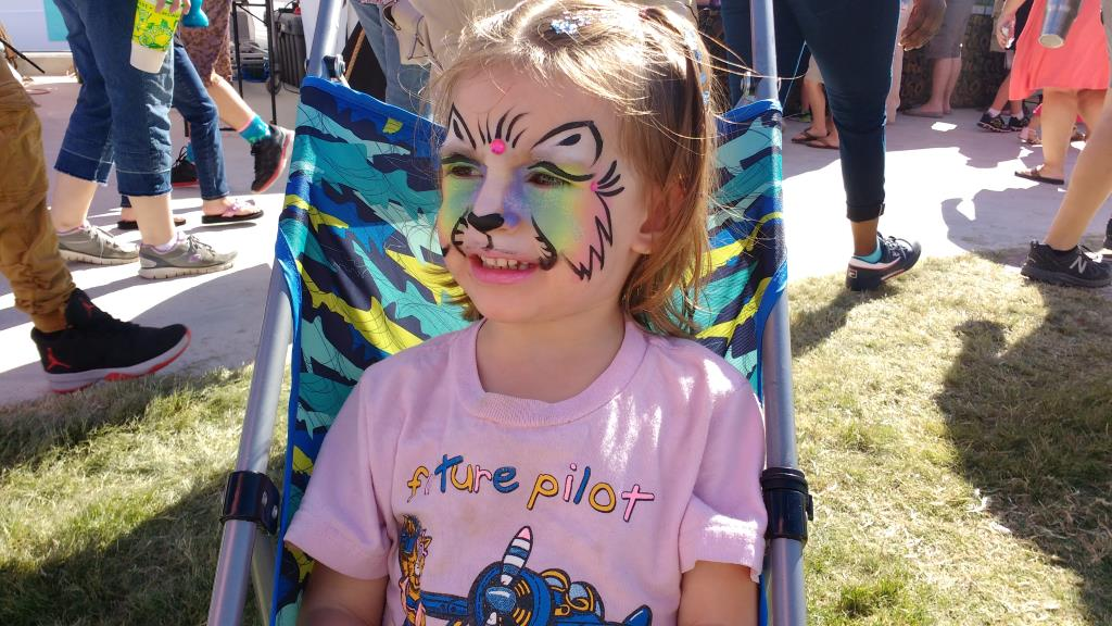 Lydia with her Rainbow Kitty face paint