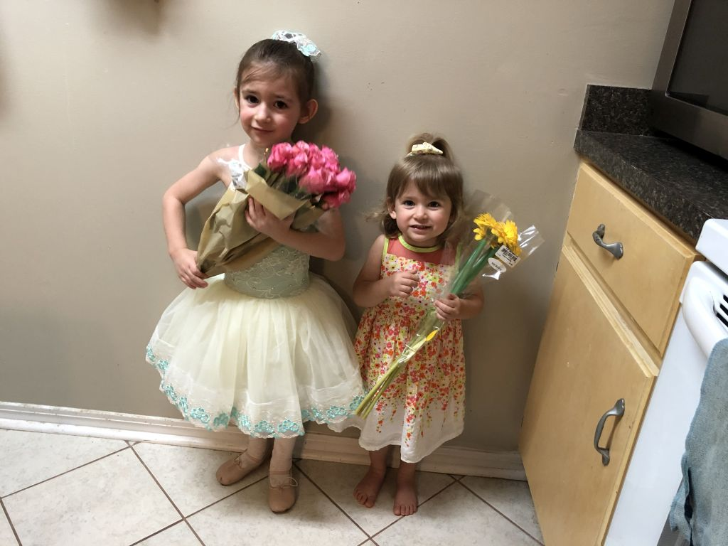 Lydia and Amber holding flowers after the ballet recital