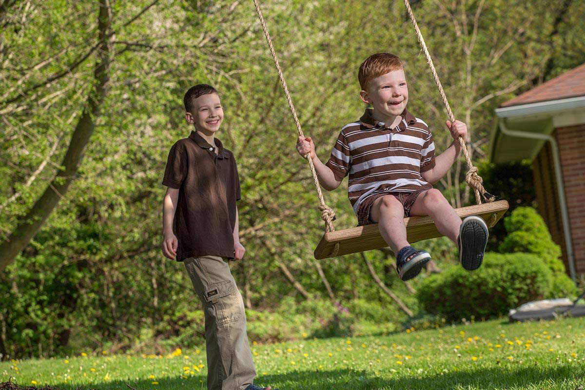 Picture of an employee's boys on a swing