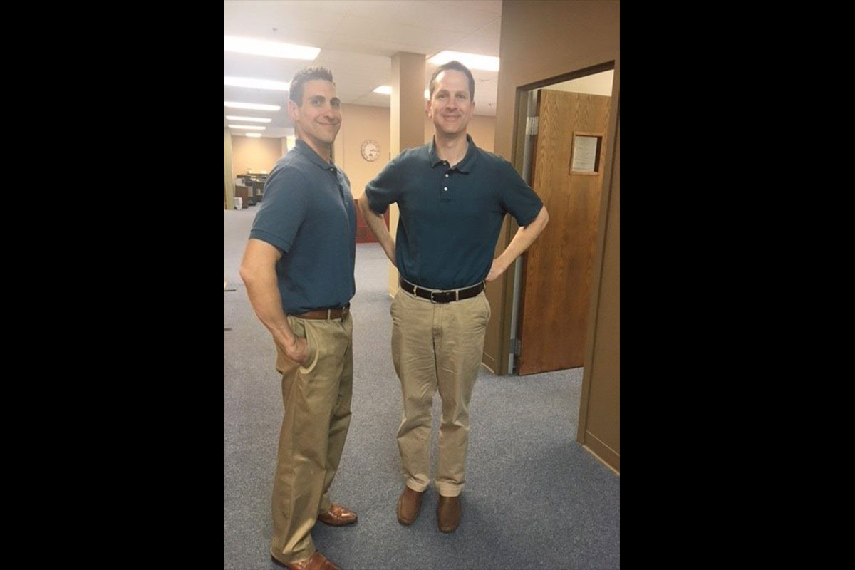 Twins?  Or just office mates that occasionally dress alike.