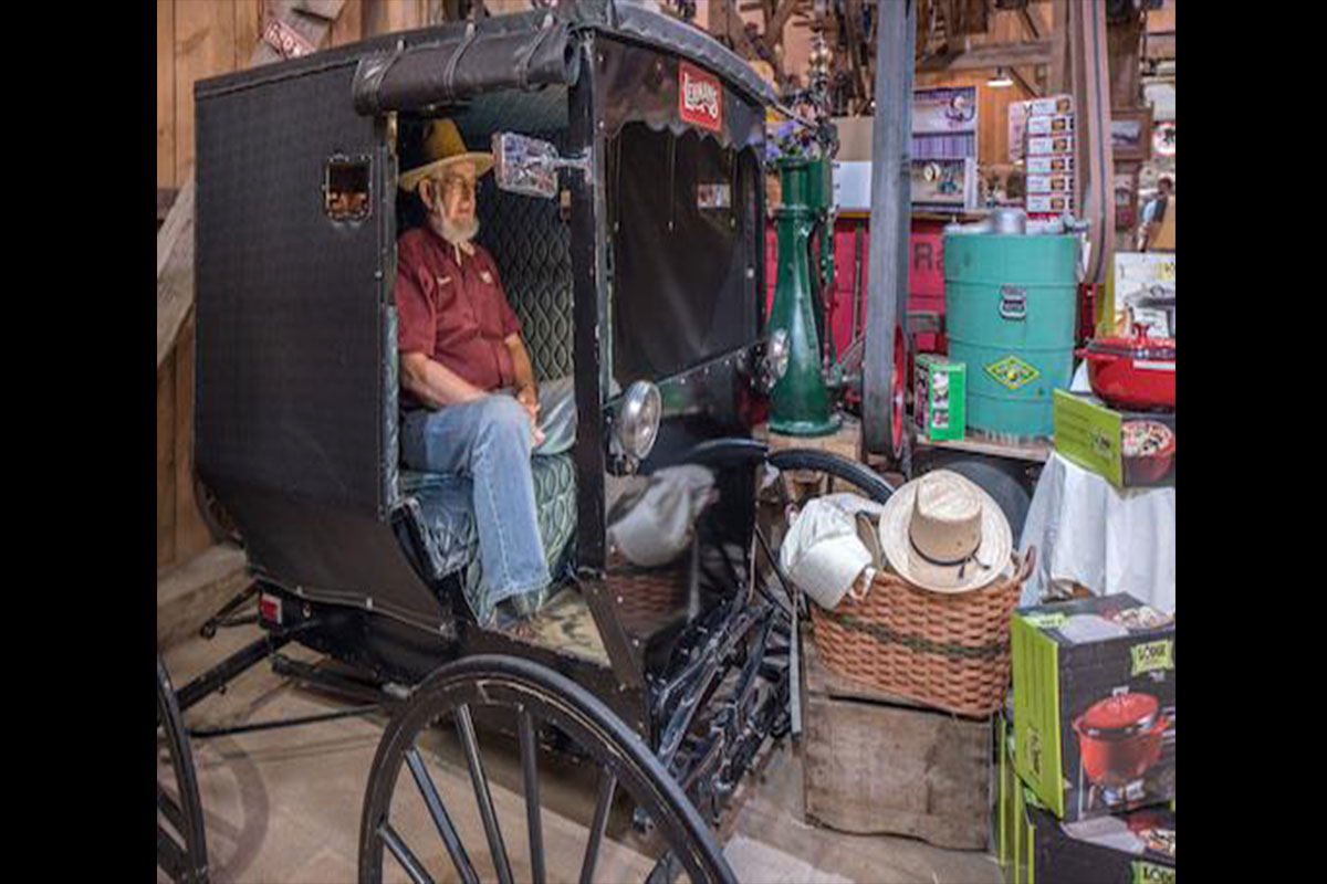 There are numerous photos opps in the store and Glen, long time employee and family member, poses in the Amish Buggy.