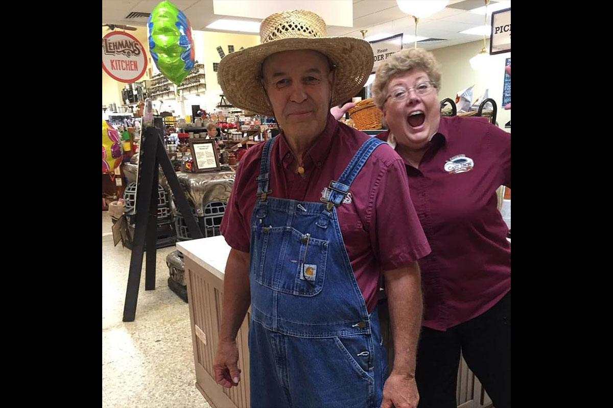 Roger, wearing is overalls for a day in the garden, gets photo-bombed by Tammy.