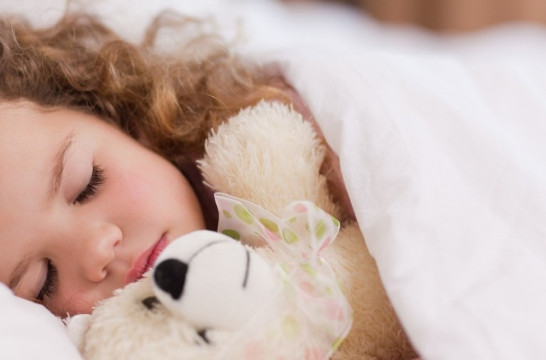 girl-sleeping-with-her-teddy-picture-id137352561
