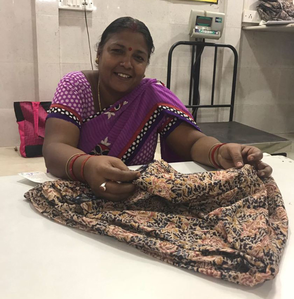 Pushpa embroidering