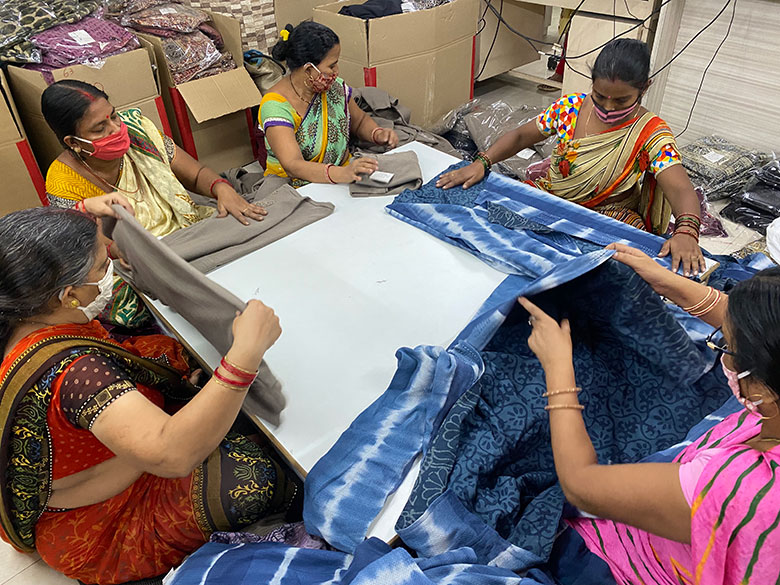 Artisans doing quality control for production