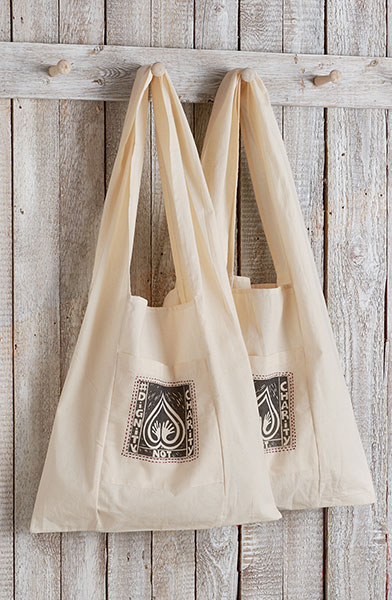 Free Dignity Not Charity Tote Bag