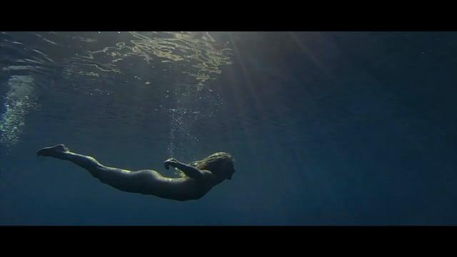 Underwater girl strips