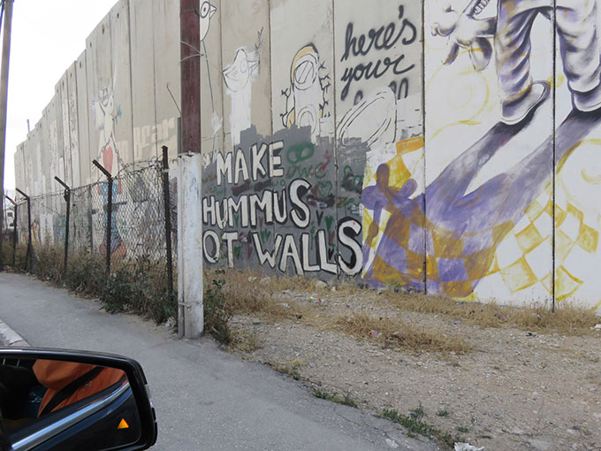Graffiti on the separation wall between Palestinian Bethlehem and Israeli territory