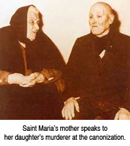 Saint Maria's mother speaks to Maria's murderer at the canonization
