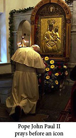 Pope John Paul II praying before an icon
