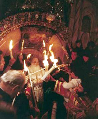 The Patriarch of Jerusalem brings out the Holy Fire from the shrine encasing the Tomb of Christ