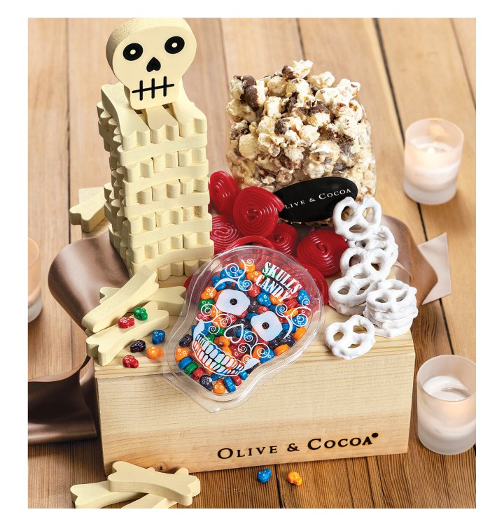 An image of Olive & Cocoas Halloween gift box with assorted halloween treats and