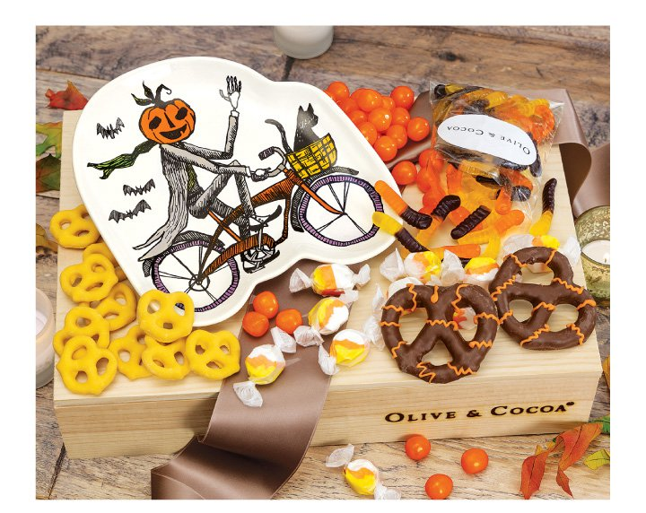 An image of Olive & Cocoas sleepy hollow plate and sweets halloween gift basket.