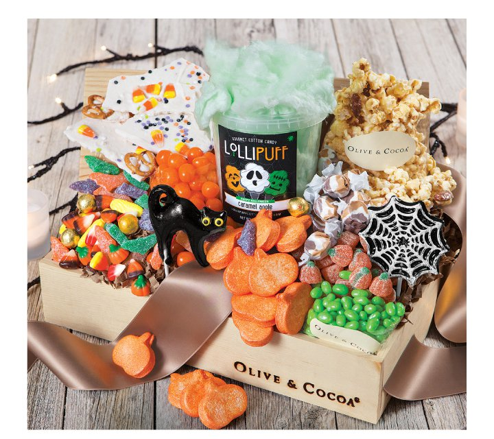 An image of Olive & Cocoas ultimate halloween candy basket featuring tons of delectable halloween treats and sweets.