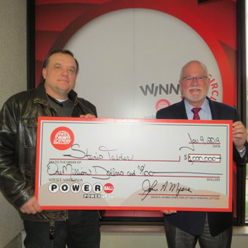Powerball Winner Stanis Tabler with West Virginia Lottery Director John Myers